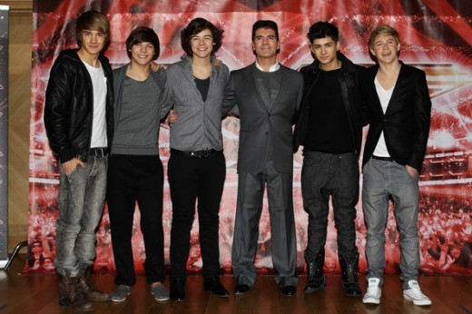 New Direction, pictured with Simon Cowell on The X Factor Image credit: zimbio.com