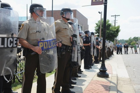 Police presence in Ferguson on August 11th 2014 image source: PBS news hour