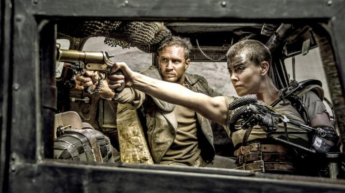 "(L-r) TOM HARDY as Max Rockatansky and CHARLIZE THERON as Imperator Furiosa in Warner Bros. Pictures' and Village Roadshow Pictures' action adventure ""MAD MAX: FURY ROAD,"" a Warner Bros. Pictures release. from Warner Bros. media site"